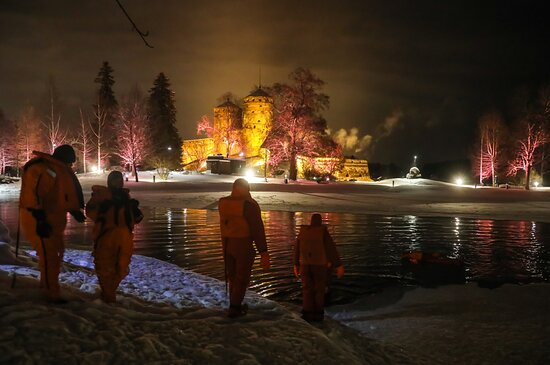 Ice-Floating Experience by Olavinlinna Castle in Savonlinna: Us getting into the Lake Saimaa icy water. Photo: Pia Behm