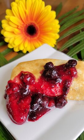 Ricotta cheese blintzes with mixed berry compote at Crave Restaurant in Richmond Hill, Ontario
