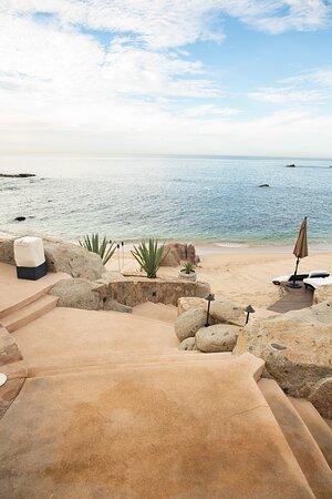 Steps down to private beach.