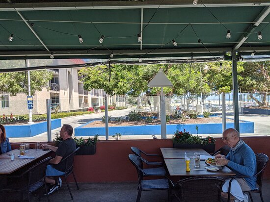 Dining with a view of the car park on Belmont Brewing Company patio.