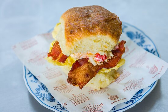 Callie's Hot Little Biscuit handmade buttermilk biscuit with crispy bacon, egg, and pimento cheese.