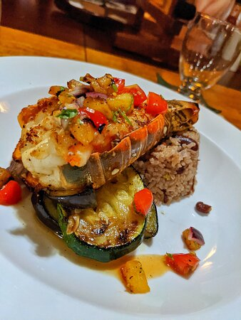 Grilled lobster with pineapple salsa, grilled veggies, and Belizean rice and beans