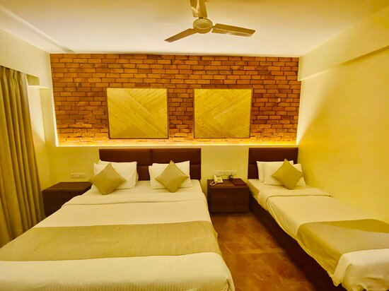Super Deluxe Room with balcony 1 king size bed & 1 single bed for 3 guests.