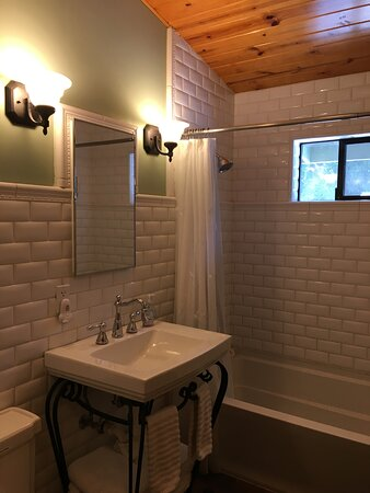 All tile bathroom with shower/tub.