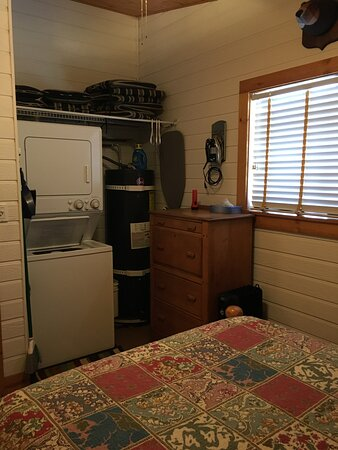 Washer/dryer in third bedroom with double bed.