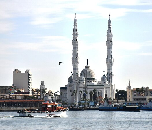 Ships passing by Port Fouad Grand Mosque