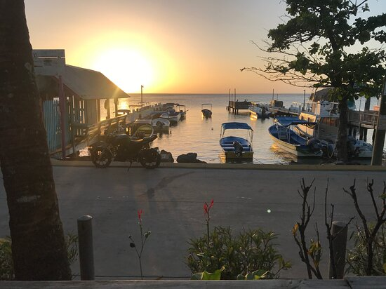 Sunset from the Splash Inn dive shop, which is attached to the hotel. The dock on the right is where you leave from for your dives. Easy and convenient as it gets1