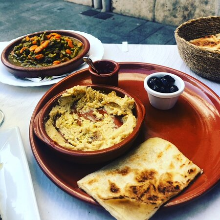 Hummus with oil cured olives and moroccan flat bread. Green bean stew