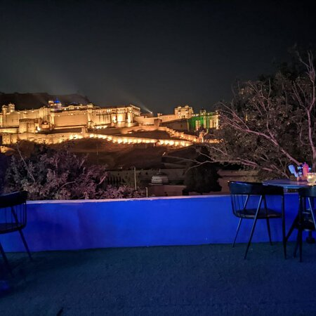 The stag cafe of Jaipur, opposite amer fort.  The rooftop is amazing. It also have a separate compartment called sheesh mahal.✨ Worth to visit 🤩... Just sit ,order,  and enjoy with the light and music program of amer fort at Stag✨