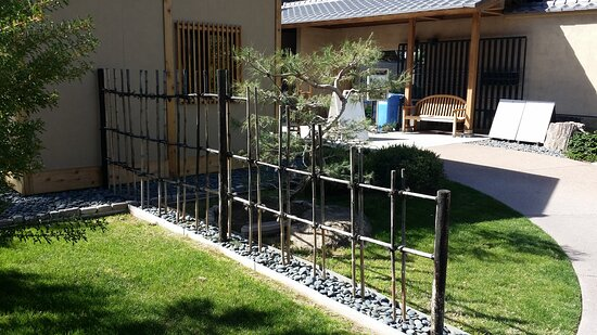 There are buildings in the Japanese Friendship Garden.  Very well designed and well maintained.   The detail of the fence is an idea to be incorporated into my Oriental garden--the wash stones at the base is a cleaver & attractive way of controlling the weeds and grasses,