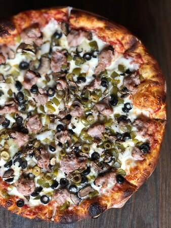 The Berrien Supreme: our house-seasoned sausage, onions, mushrooms, black olives, green peppers, and green olives.