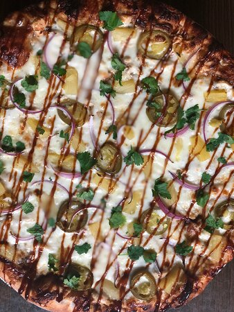 The Backyard BBQ: KC Masterpiece BBQ Sauce base, shredded seasoned chicken, red onions, pineapple, and jalapeño, topped with fresh cilantro and drizzled BBQ sauce.