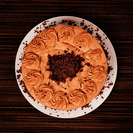The Turtle Cheesecake: A slice of our heaven. Chocolate cracker base, filled with homemade caramel, all wrapped in a decadent chocolate cheesecake batter.