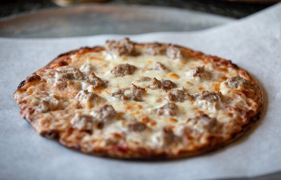 Check out our Cauliflower Crusted Personal Pizza with your choice of toppings! Photo: Justin Huard