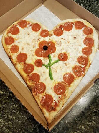 Happy Valentine's Day! Be sure to call in your custom orders for our Valentine's Day Heart Shaped Pizza!
