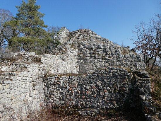 reddened limestone blocks, maybe from fire