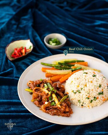 Beef Chilli Onion with mixed fried rice and sauteed vegetables.