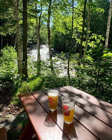 Picnic table available by the river to eat (seasonal)