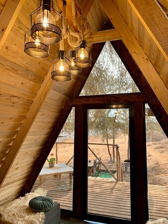View and deck out to the sand dunes from the A-Frame Cabin