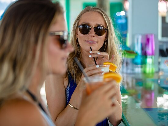 Enjoy drinks at the upstairs bar at Laguna's Beach Bar + Grill