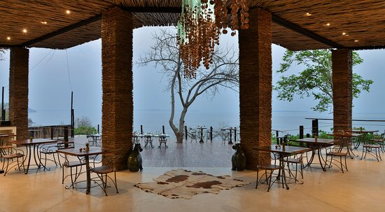 Outdoor dining space with a view of lake kariba
