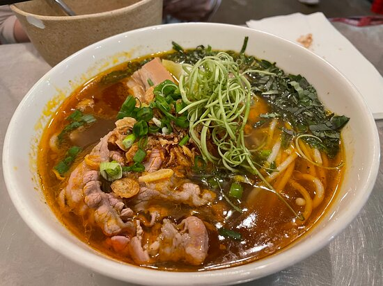 robust Hue style beef broth, roasted shallot and ginger, lemongrass, pineapple, beef brisket, beef balls, rare beef, cha hue pork sausage, fried shallots, fresh herbs and rice vermicelli