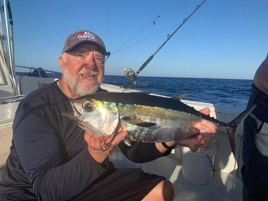 Mr. Al happy with the blackfin tuna he caught.