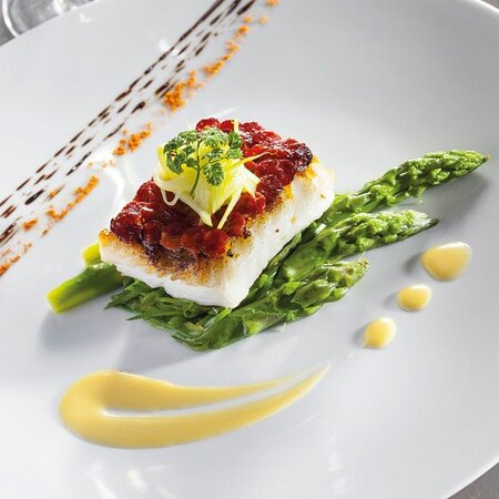Fish surrounded by seasonal vegetables