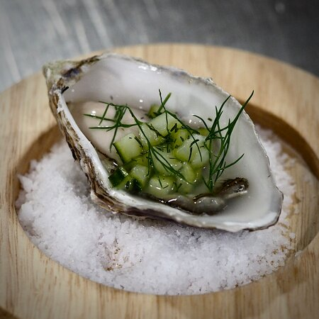 Porthilly oyster with cucumber and dill pickle.