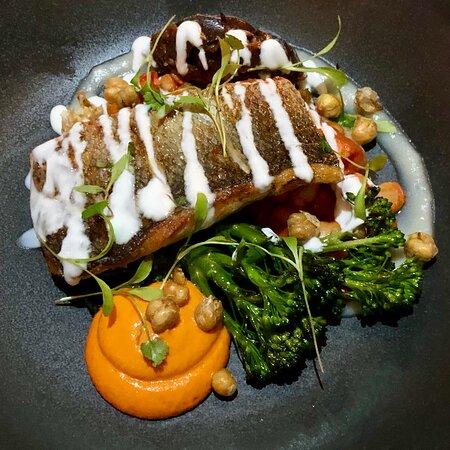 Sea bass, chickpeas, spiced aubergine, romesco sauce.