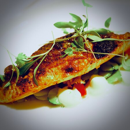 Barbecue mackerel, broad beans, tomato and smoked crème fraîche.