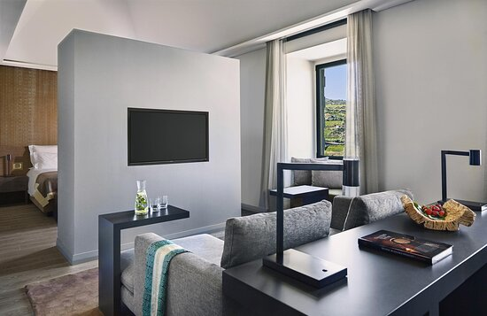 Suites have a spacious separate living area with wooden floors
