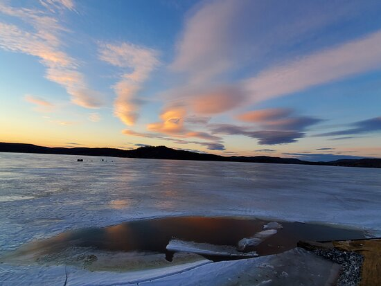 Bomoseen, VT: Frozen over lake with sunset.