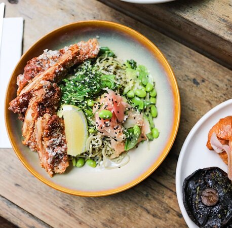 Green Tea Noodle Salad Japanese-style green tea noodles with green beans, snow peas, edamame, cucumber, avocado, pickled ginger, wakame & ginger-miso dressing. You can also add Karaage chicken or Crispy marinated tofu!
