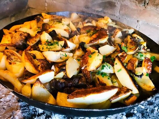Veal  roasted under the bell with potatoes and vegetables