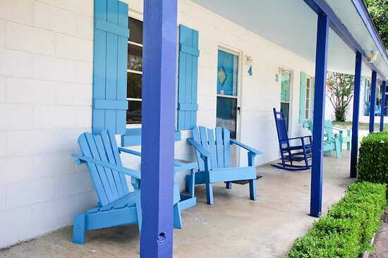 Cabins have comfy chairs and lake views.