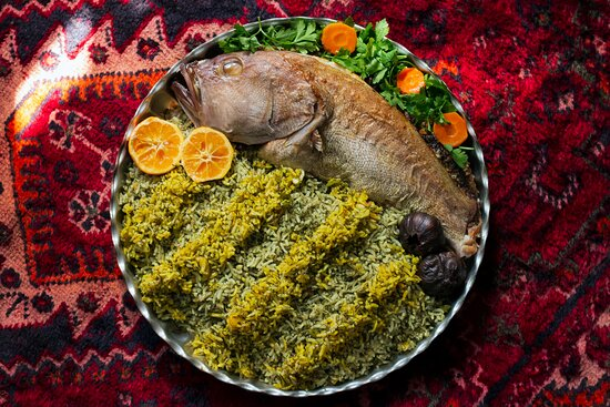 """Shiraz, Iran: Herbed rice with fried fish """"Sabzi polo ba mahi-سبزی پلو با ماهی"""" is the main dish for the Persian new year""""Nowruz"""". Iranian believe that its greenness is a symbol of bounteousness and happiness. the fish is also the symbol of life and abundance. Iranian people eat this food for the new year in order to have a healthy year of abundance.    Photo: @adnanlarijani"""