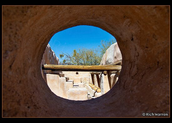 """Looking at a storage room through a """"porthole"""" of one of the thick walls surrounding it."""