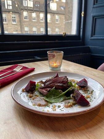 Pan seared pigeon breast with walnut crumble and fresh salad