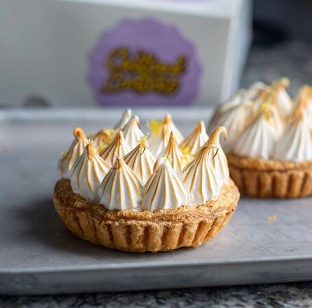 Lemon puff tart  Our hand made buttery puff, zingy lemon curd topped with torched meringue.