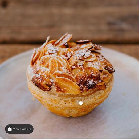 Almond croissant tart  Custard's gorgeous, flaky and oh-so-buttery puff pastry is filled with almond frangipane and creme patissiere. Also available in a 6 pack!