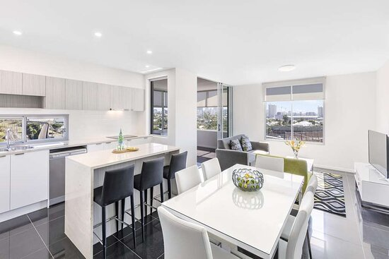 Interior view of kitchen, dining area and lounge in Two Bedroom Suite