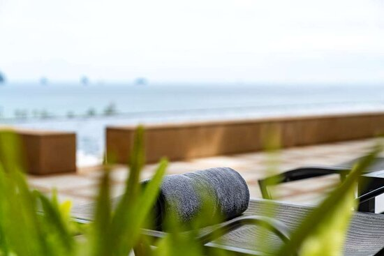 Detail of sun-loungers at Infinity Pool with view of ocean