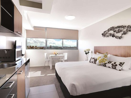 Interior view of bedroom, dining area and kitchenette in Studio