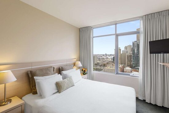 Interior view of bedroom in One Bedroom Suite with city view