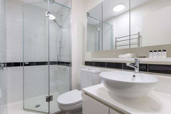 Interior view of bathroom in Two Bedroom Executive Suite with shower