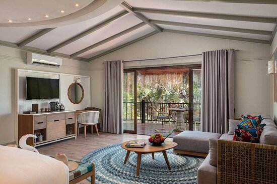 Interior view of marine-themed lounge area in Beach Pool Villa and Beach Villa with garden view
