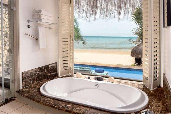 Interior view of bathtub in Beach Pool Villa and Beach Villa bathroom with beach and ocean view