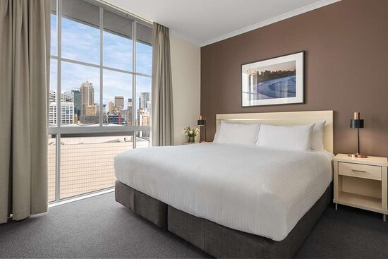 Interior view of bedroom in Two Bedroom City Skyline Executive Apartment with city view