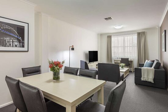 Interior view of dining area and lounge in Two Bedroom City Skyline Executive Apartment